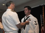 Hospital Corpsman 2nd Class (FMF) Jake Emmott receives the Silver Star from Vice Chief of Naval Operations Adm. Jon Greenert during the third annual Safe Harbor awards ceremony July 14, 2011